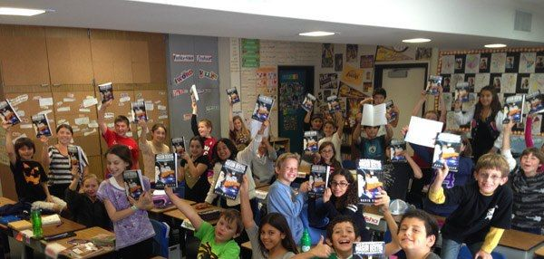 Students Holding their copies of Mason Dexter: The Original Adventure